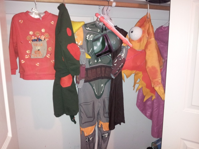 Boba Fett hanging with costumes of years past in Noah's closet (staged. He's EIGHT. No eight year old has a tidy closet with only Halloween costumes in it.)